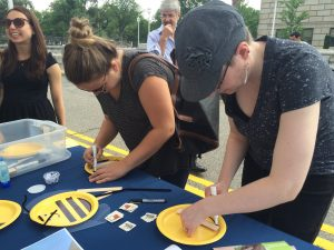 USDA Employees create bee fans at Pollinator Festival